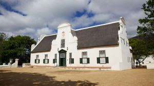Groot Constantia, the finest surviving example of Cape Dutch architecture, and one of South Africa's foremost historical monuments tourist attractions, dates back to 1685. Groot Constantia has been producing wine for more than three centuries. In 1685, Simon van der Stel, the later governor of the Cape, was granted land for a farm, which he named Constantia. When he died the property was divided and a smaller farm created around the homestead. The vineyards are tucked in a steep valley on the eastern side of Table Mountain. The name Constantia is irrevocably linked to the most famous wines to be made in South Africa.